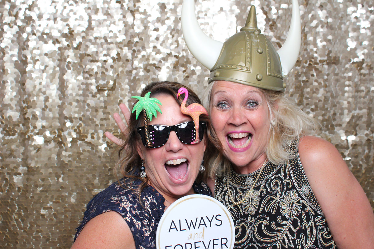 Parent wearing funny hats with gold backdrop at Jacksonville Photo Booth Rental.