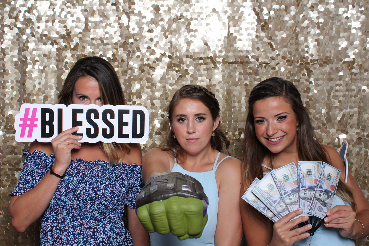 Blessed sign with money in front of gold backdrop at Jacksonville Photo Booth Rental.